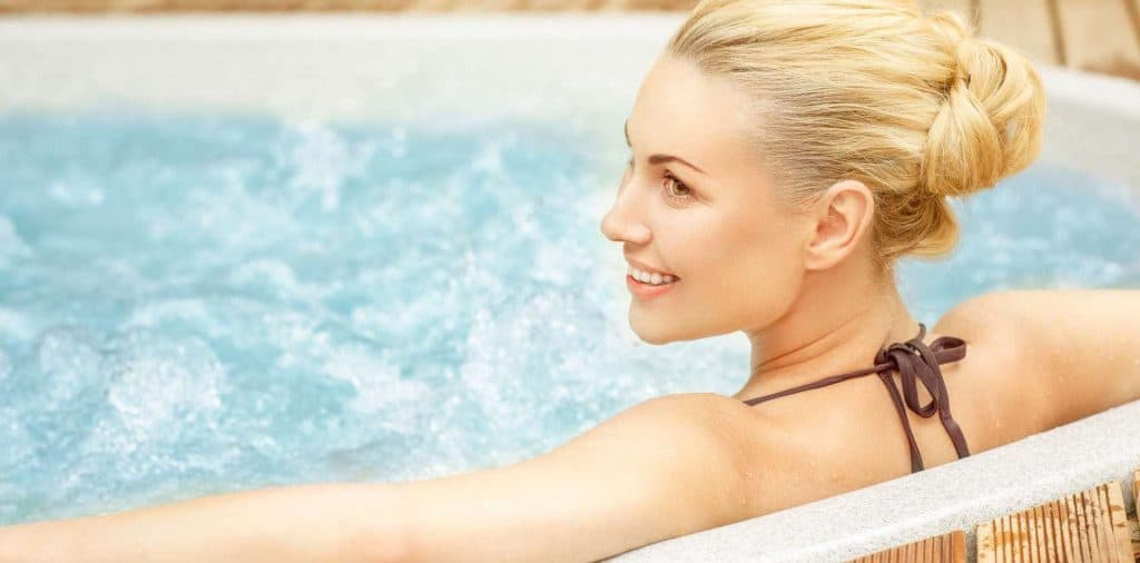 woman sitting on a working hot tub